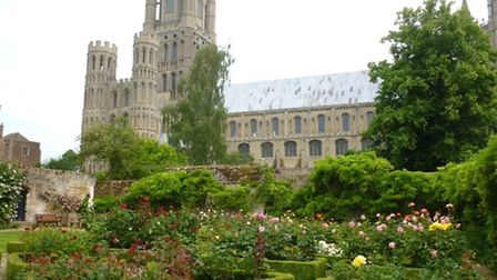 Two extreme sport enthusiasts jump from the West Tower of Ely Cathedral