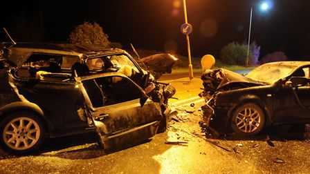 The wreckages of the two cars following the crash.
