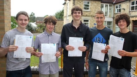 Students at Soham Village College with their results, from left: Andrew Figgins, George Tuli, George