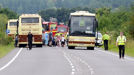 Emergency services at the scene of a coach crash on the A10 near Hilgay - A coach turns up to take c