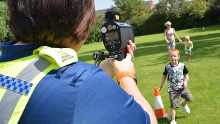 Picnic with the Police, at High Barns Community Centre, Ely, PCSO Emma Graves, with the speed gun on