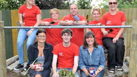 Tesco staff volunteering to Paint school fences for the play group at Thomas Eaton school, Wimblingt