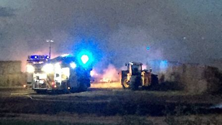 Firefighters tackling the straw blaze at a farm in Whittlesey Road, Benwick.