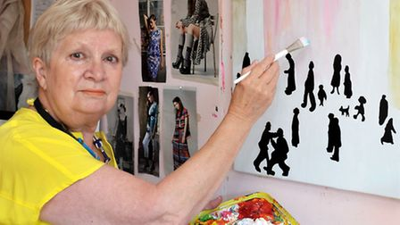 Artist Janet Payne from Whittlesey in her studio. Janet working on her homage to Lowry. Picture: Ste