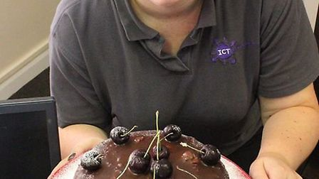 Rudy with her Black Forest Gateau. Picture: CAMBS FIRE.
