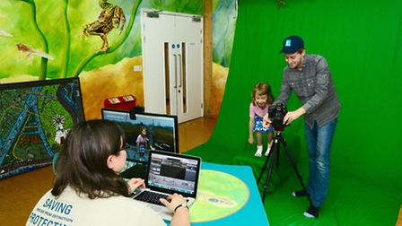 Child and staff using the green screen. Picture: BOB ELLIS