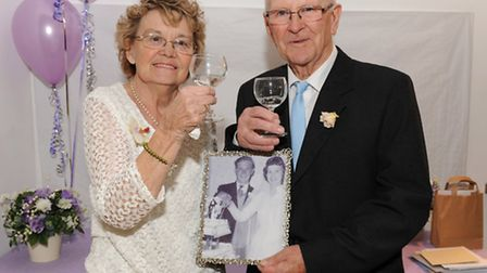 Norman and Hazel Gale with their wedding photograph. Picture: ROB MORRIS