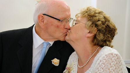 Norman and Hazel Gale celebrate with a kiss. Picture: ROB MORRIS