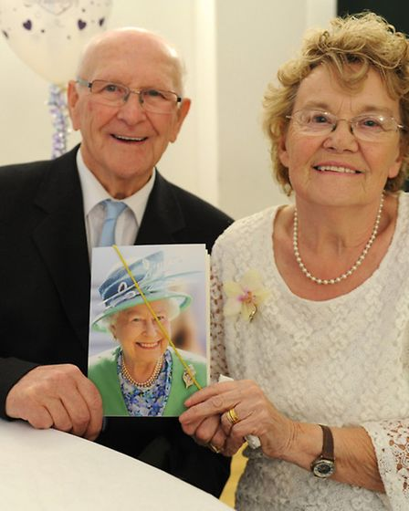 Norman and Hazel Gale with their card from the Queen. Picture: ROB MORRIS