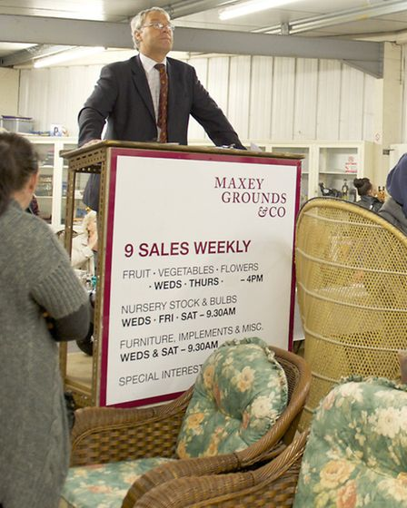 John Maxey in the auction hall
