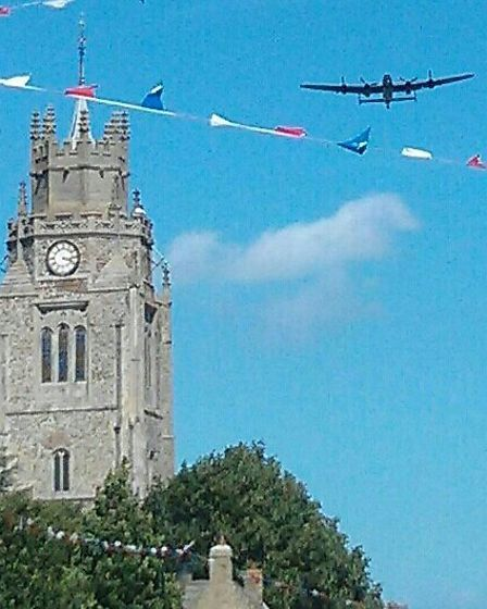 A Lancaster bomber flies over Sutton during the summer Festival Week.