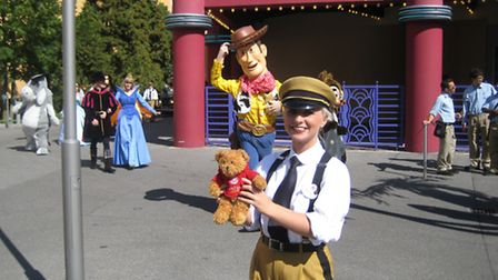 Spending time with Woody and a guide at Disneyland.
