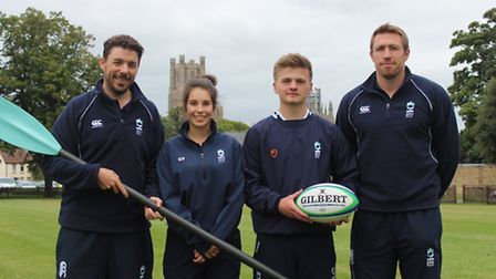 Left Mark Beer, rowing coach and far right Jim Thompson the new rugby coach at King's Ely with two p