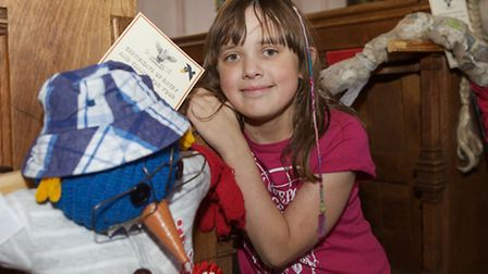 Kezia Towning aged 10 with her winning scarecrow.