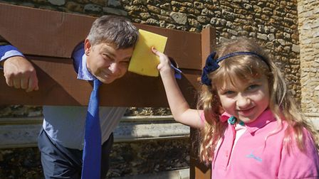 Rob Skoulding in the stocks with his daughter Chloe aged 9 ready to throw the first sponge