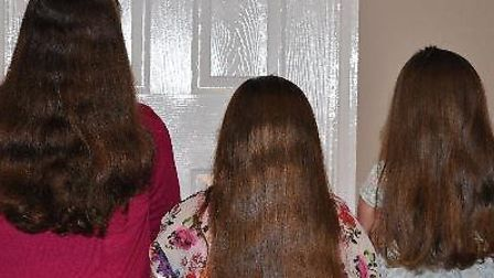 Wendy Ransome and her grand daughters have their hair cut for the Little Princess Trust
