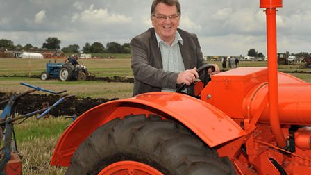 Ely Standard Editor John Elworthy on a tractor at the 2013 event.