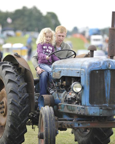 Haddenham Steam Rally, Lily Oliver, catches a ride with Nathan Jennings, from Sutton,
