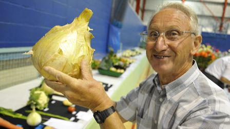 Ely Horticultural Society Autumn Show, Judge Roy Bonnett, with one of the onions,