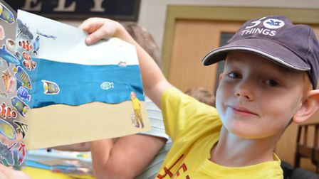 Summer Crafts at Ely Museum, Oliver, from Ely, with his beach scene,