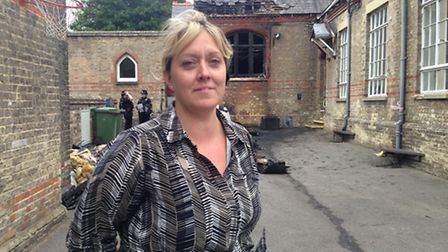 Jane Segust, deputy head at Exning Primary School, outside the school, which has been damaged in an