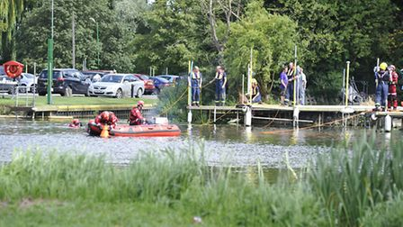 Emergency services search for a missing person.
