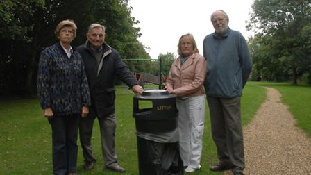 Takeley Parish Councillors with one of the vandalised bins. From left: Trisha Barber, Trevor Allen,