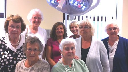 The Friends of Doddington Hospital Co ordinating Committee, below the new theatre light for the Outp