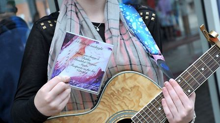 Holly Orridge playing at the Horsefair shopping centre Summer Funday. Picture: Steve Williams.
