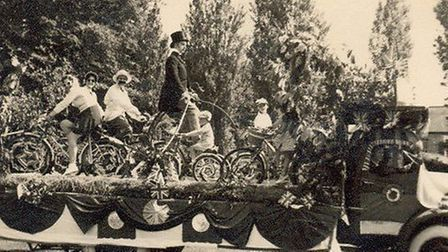 From 1950 Soham Carnival float. Roland Pollard (cycle/car sales) on pennyfarthing and Dorothy Long o