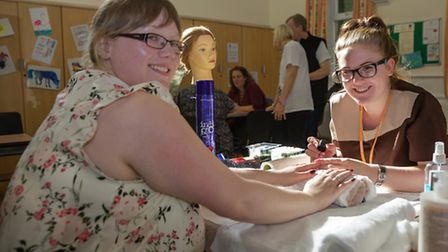 Rhiannon Eggelton having her nails painted by Sonya Rix from Hair & Beauty at The College Of West An