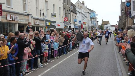 Winner racing home through streets lined with cheering crowd!