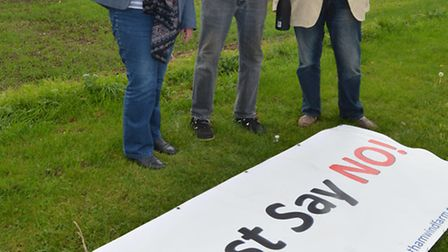 Red Hill Wind Farm refused, celebrating (l-r) Lesley Goad, Paddy Goad, and Councillor Bill Hunt,
