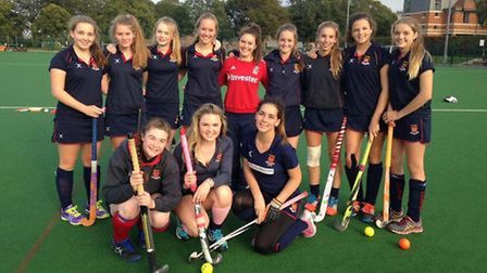 Felsted's elite hockey players with gold medallist Laura Unsworth (centre)