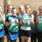 Some of the City of Ely Netball under-14s with the nail files donated by Greys of Ely.