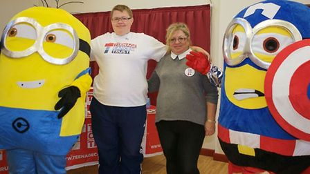 Ryan with his mum Jolanta Large and a pair of Minions from Discover Your Mojo