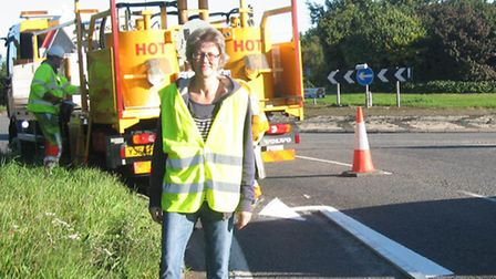 Councillor Anna Bailey helps traffic to flow easier around Ely with new painted arrows