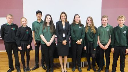 MP Lucy Frazer with Bottisham college students, one of the teams taking part in a debating challenge