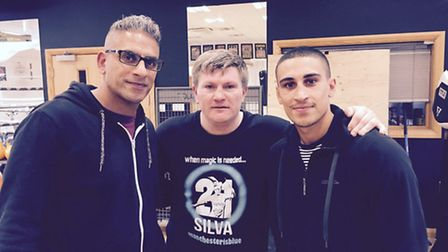 Boxer Jordan Gill (right), with his father and coach Paul Gill (left) and former World Champion Rick