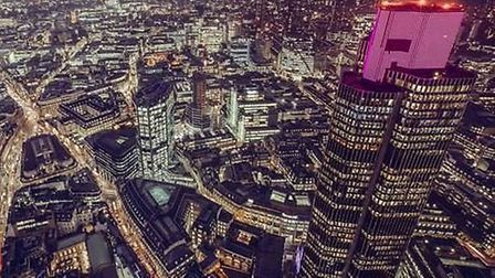Tower 42 in London glows pink as part of Wear it pink