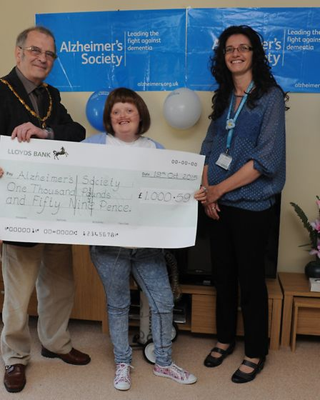 Councillor Alex Miscandlon Mayor of Whittlesey and Anna Clark presenting cheque to Alison Harrison S