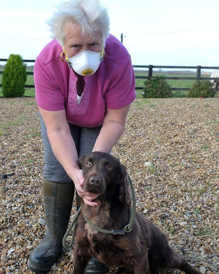 Ruby Baxter with the mask she has to wear outside. Picture: Steve Williams.