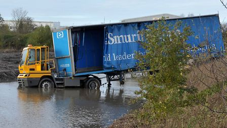 Smurfit Kappa lorry and trailer in drainage pond. Picture: Steve Williams.