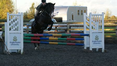 Phoebe Plumb on her horse, Lester, at the Show Jumping County Qualifier, held at the College of West