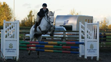 Rachael Attwood on Flo Flying Fantasy at the Show Jumping County Qualifier, held at the College of W