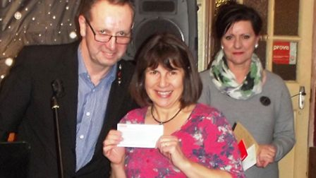 Max (left) and Diane (right) of Plumtree Farm present a cheque for £500 to Jayne Bradshaw of Whittle