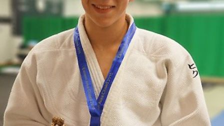 Noah Aldous shows off his Ippon Trophy he won at the Eastern Area Low Grade Contest