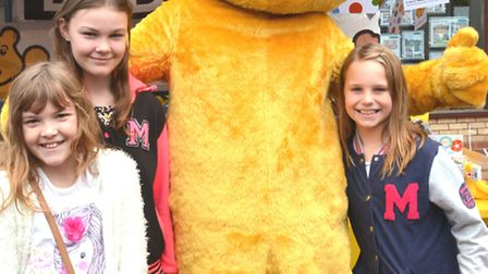 BBC Radio Cambridgshire visit Ely Market Place, with Pudsey, and (l-r) Annabel, Emily, from Durham,