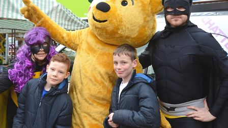 BBC Radio Cambridgshire visit Ely Market Place, with Pudsey, and (l-r) Presenter Sue Marchant, Harry