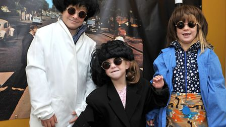 Harry, Katie and Eloise Martin dressing up in the 60s clothes. Picture: Steve Williams.